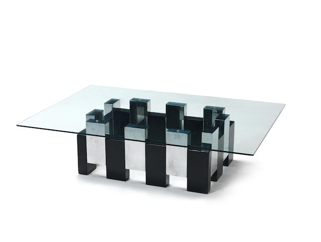A ebonised and chromed metal coffee table with clear glass top Italian c 1970