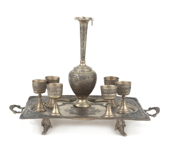 A Continental hammered brass cordial set