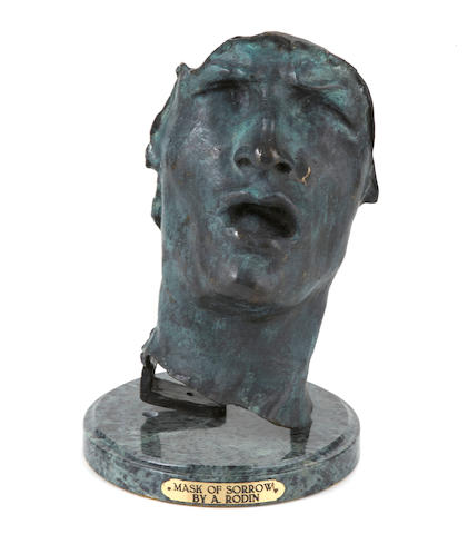 A bronze study of a face on stand, Mask of Sorrow