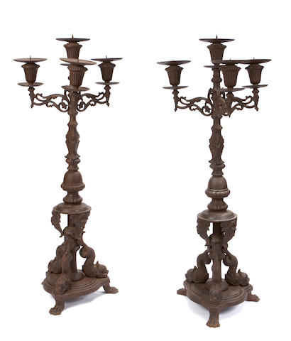 A pair of Rococo style cast iron four light torchieres