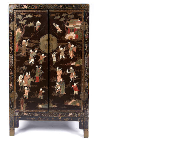 A Chinese hardstone inlaid cabinet