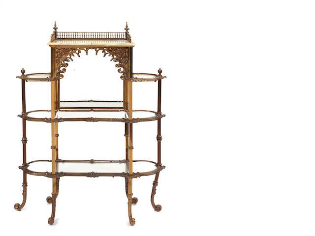 A Belle Époque style gilt metal and onyx étagère