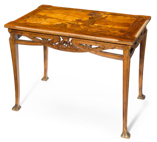 A Louis Majorelle marquetry and mahogany writing table circa 1900