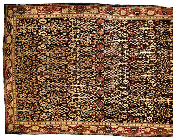 An Agra carpet (finely reduced in length) India size approximately 16ft. 1in. x 23ft. 1in.