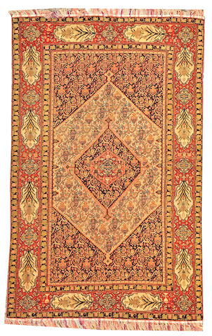 A Senneh carpet Northwest Persia size approximately 6ft. 6in. x 9ft. 2in.