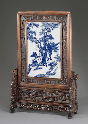 A blue and white porcelain-mounted wood table screen