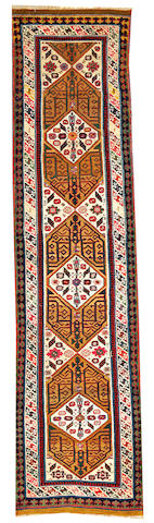 A Caucasian runner Caucasus size approximately 13ft. x 4ft.