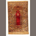 A Turkish silk rug Turkey approximately 5ft. 10in. x  4ft. 2in.