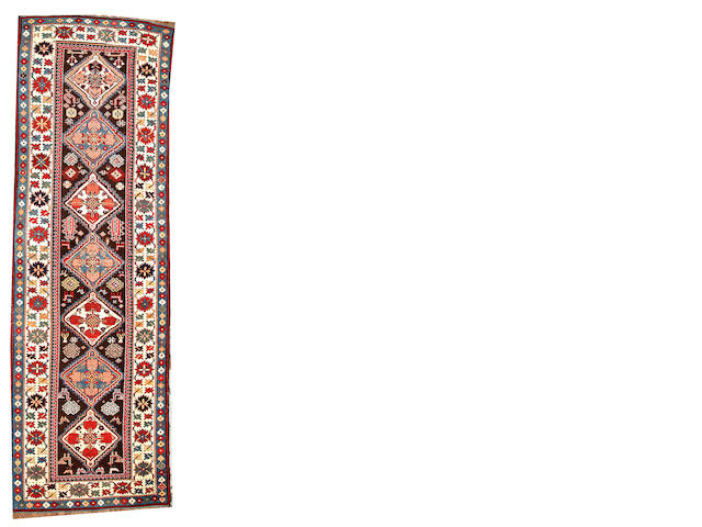 A Kuba runner Caucasus size approximately 3ft. 2in. x 10ft.