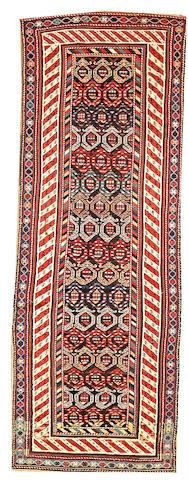 A Kurdish runner Northwest Persia size approximately 3ft. 7in. x 9ft. 10in.