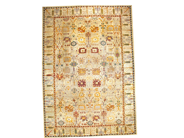 An Agra carpet India size approximately 10ft. 1in. x 18ft. 9in.