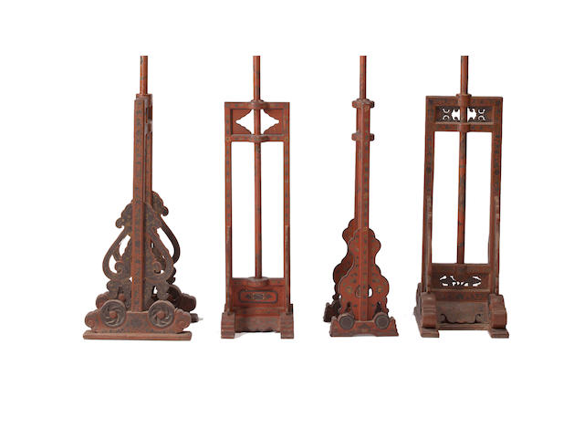 A group of four red lacquer and gilt decorated lantern stands Late Qing/Republic period