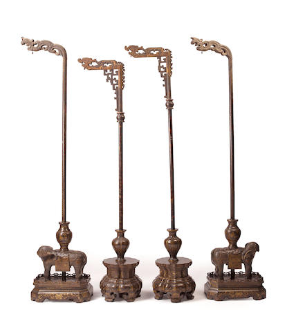 Two pair of black lacquered wood lantern stands 19th century