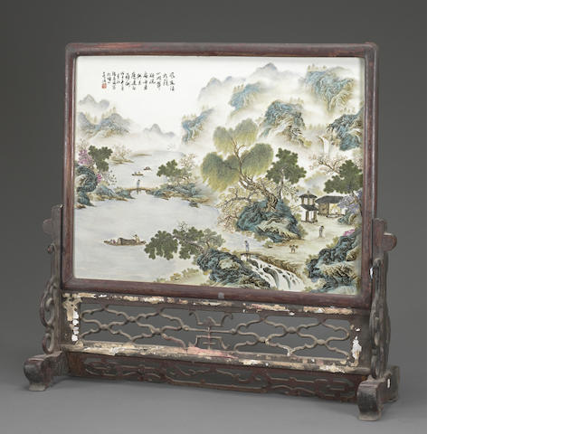 A wood-framed famille rose enameled porcelain plaque mounted as a table screen 20th century