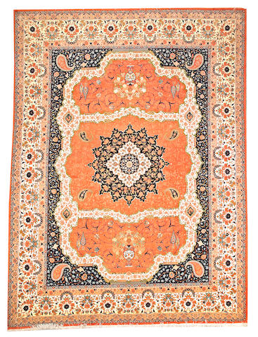 A Tabriz carpet Northwest Persia size approximately 9ft. 7in. x 13ft.