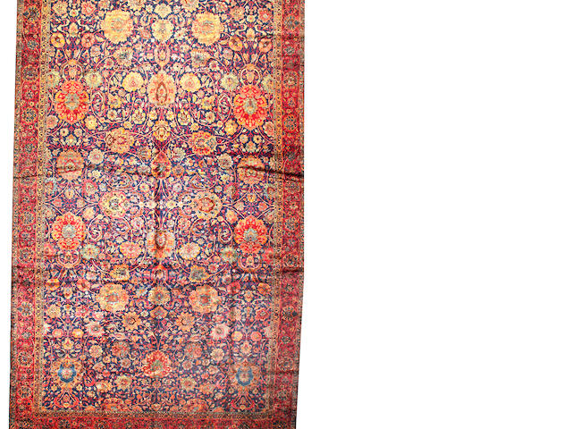 A Kerman carpet South Central Persia size approximately 12ft. 7in. x 25ft.