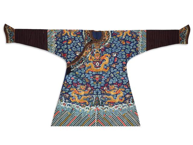 A blue silk ground embroidered dragon robe 19th century