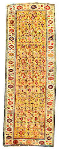 A Kuba runner Caucasus size approximately 3ft. 1in. x 8ft. 5in.
