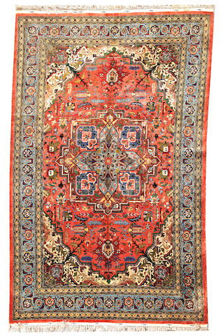 A Contemporary Silk Tabriz carpet  Central Persia size approximately 6ft. 7in. x 10ft. 6in.