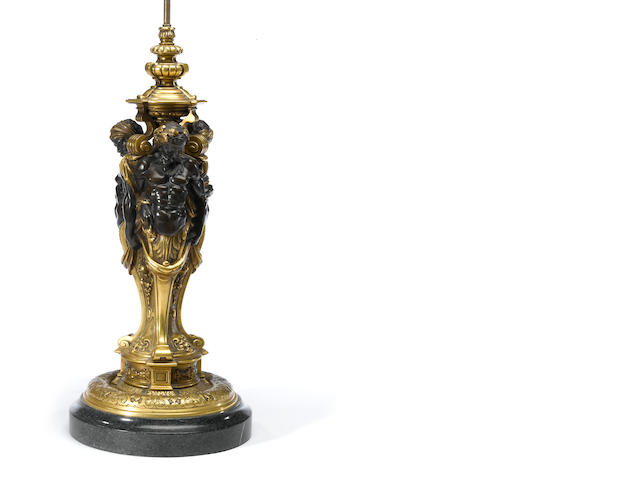 A Regence style gilt and patinated bronze figural standard<BR />late 19th century