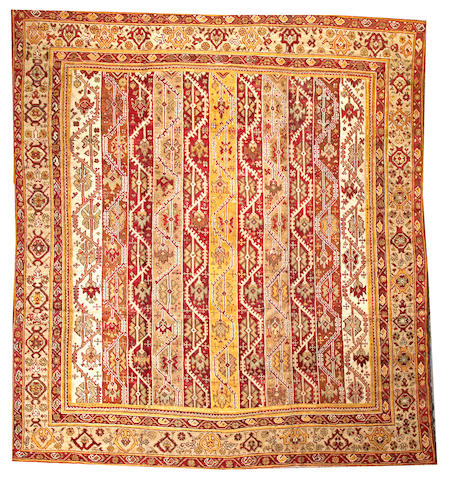 An Oushak carpet West Anatolia size approximately 11ft. 8in. x 12ft. 11in.