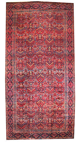 A Kerman carpet circa 1920 size approximately 10ft. 8in. x 21ft. 3in.