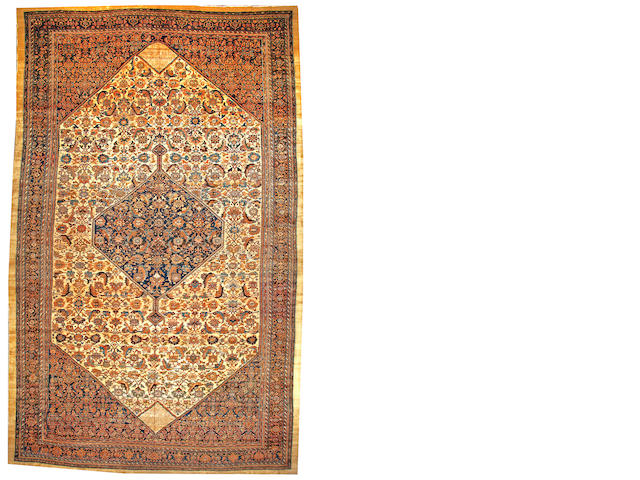 A Sultanabad carpet Central Persia size approximately 14ft. 1in. x 22ft. 10in.