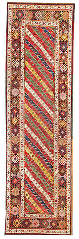 A Kazak runner Caucasus size approximately 3ft. 9in. x 12ft. 8in.