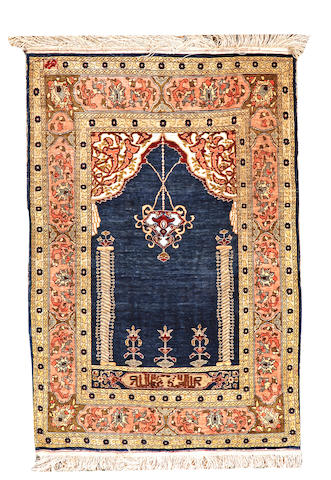 A silk Hereke rug Turkey size approximately 2ft. x 3ft.