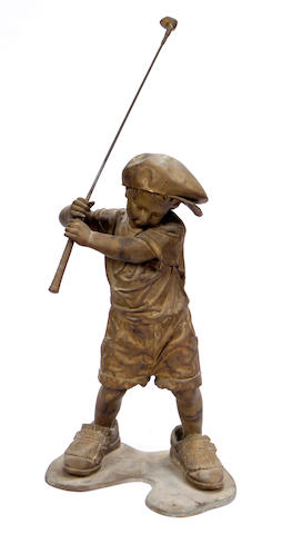 A patinated bronze figure of a golf player