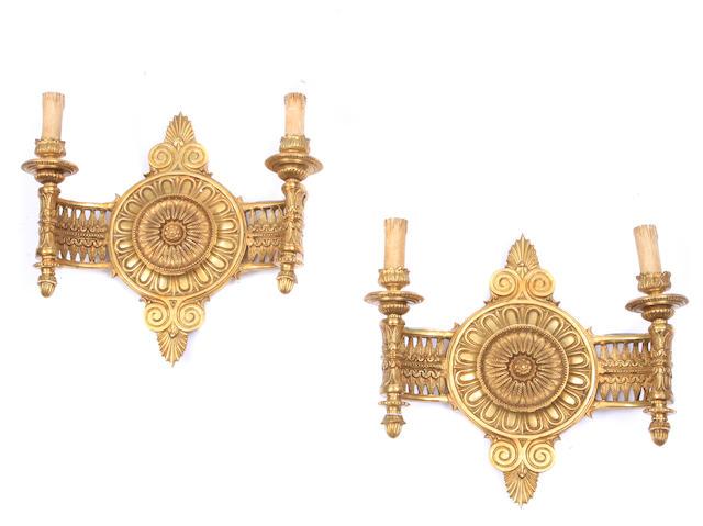 A pair of Louis XVI style gilt bronze bras de lumière