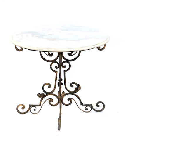 A wrought iron and marble center table