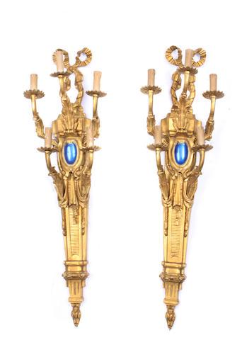 A pair of Louis XVI style gilt bronze five light bras de lumière