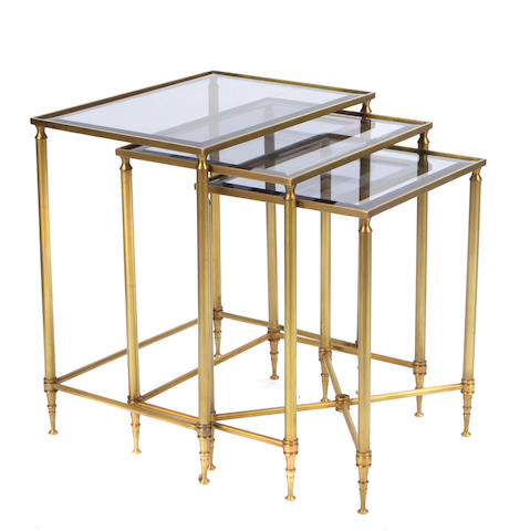A set of three Neoclassical style gilt metal and glass nesting tables