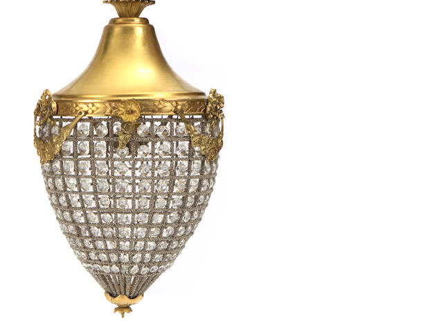 A pair of Louis XVI style gilt metal and glass lanterns