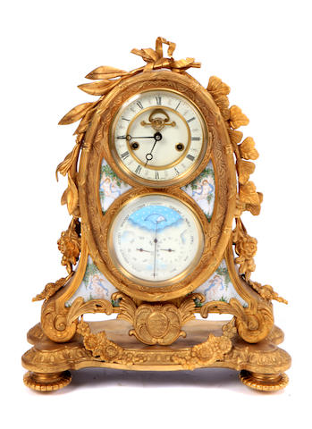A Louis XV style bronze and enamel mantle clock