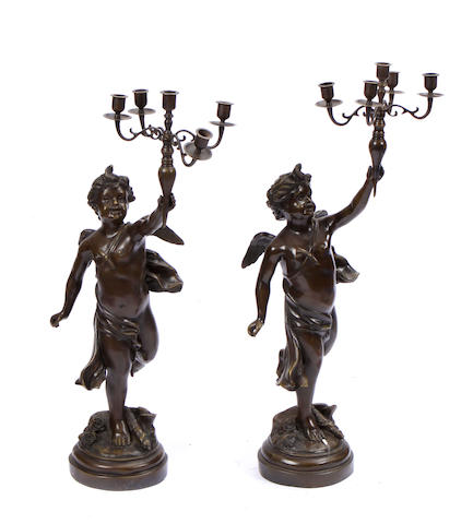 A pair of Rococo style patinated bronze five light candelabra