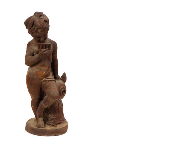 A cast iron garden figure of a child playing pipes