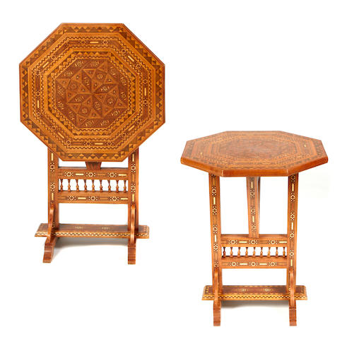 A pair of Moorish style tilt-top side tables