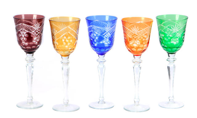 A set of thirty six colored cut glass goblets