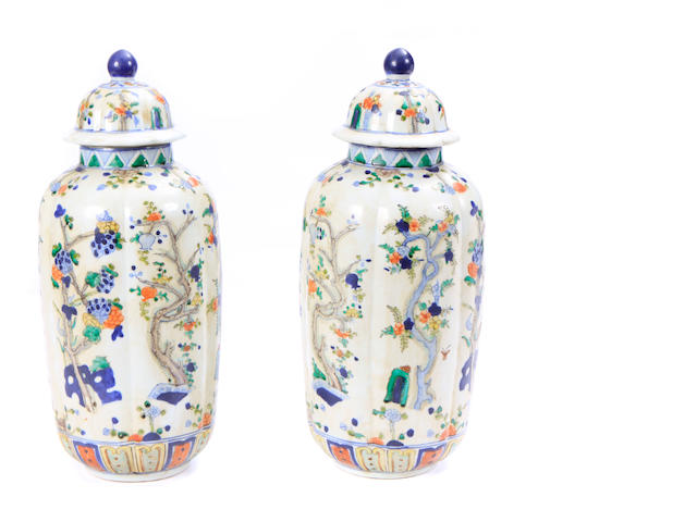 A pair of Chinese polychrome decorated covered vases