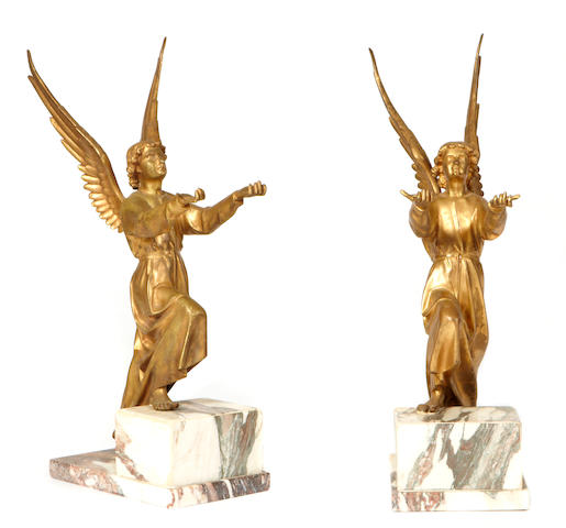 A pair of gilt bronze cherubs on marble bases
