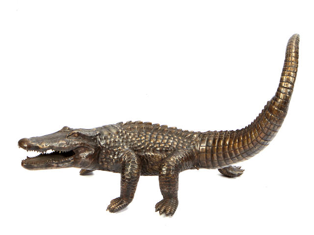 A patinated bronze model of a crocodile