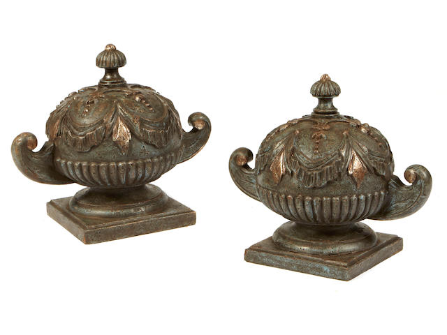 A pair of Italian Neoclassical style paint decorated carved wood urns