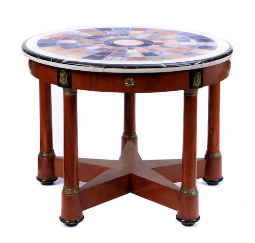 An Empire style gilt metal mounted table with specimen marble top