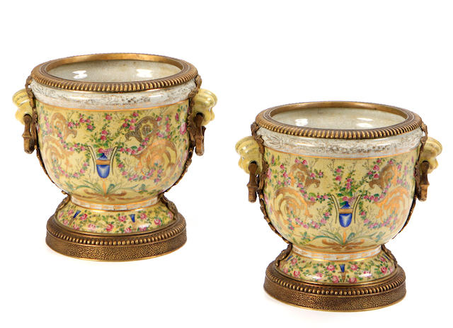 A pair of Neoclassical style gilt bronze mounted porcelain compotes