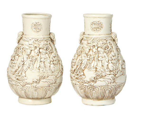 A pair of Chinese relief decorated vases