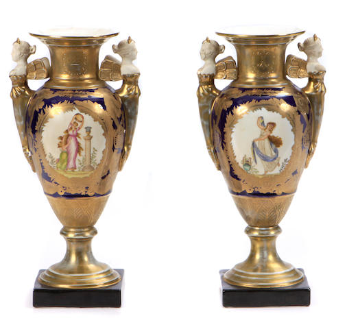 A pair of Neoclassical style paint decorated porcelain vases