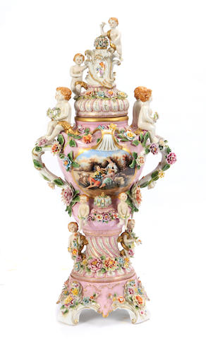 A German Rococo style porcelain covered urn