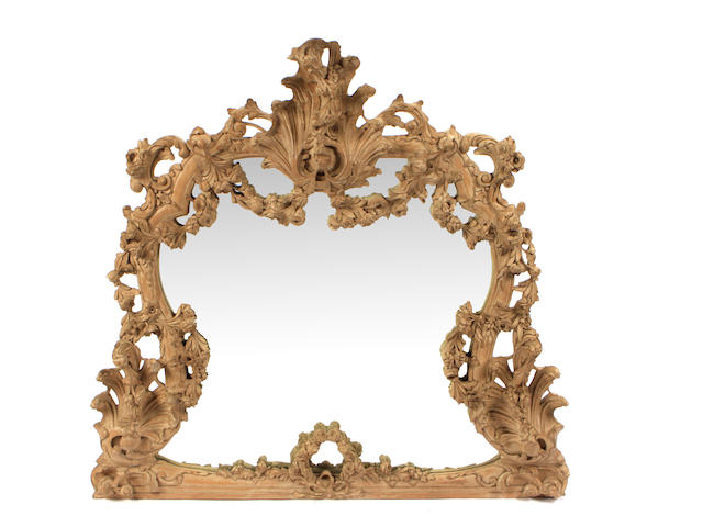 An imposing Continental Rococo style carved pine mirror
